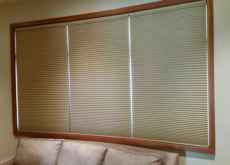Media Room Hunter Douglas hardwired motorized Duette honeycomb shades featuring top down or bottom up control.