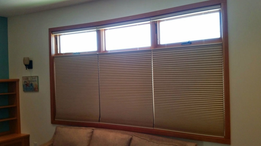 Media Room Hunter Douglas hardwired motorized Duette honeycomb shades featuring top down or bottom up control. With top's down.