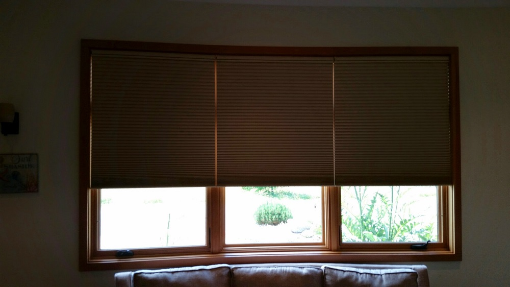 Media Room Hunter Douglas hardwired motorized Duette honeycomb shades featuring top down or bottom up control. With bottoms up.
