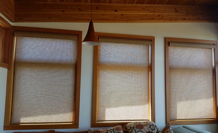 Nook Hunter Douglas motorized roller shades with Somfy motors and decorative cassette headrail.