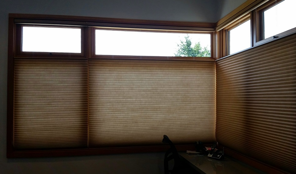 Bedroom Hunter Douglas motorized Duette shades with hardwired power. These are in a top down/bottom up configuration providing maximum privacy and versatility.
