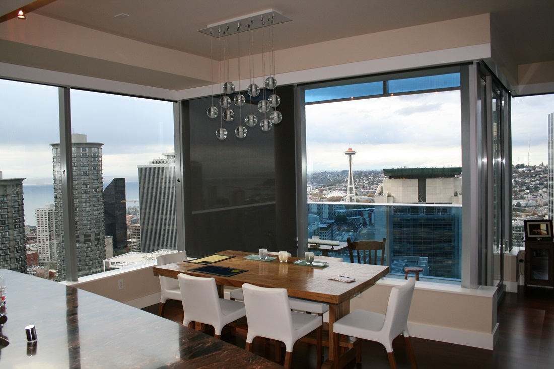 The Space Needle from Olive 8 and view through the Lutron QED motorized roller shades.