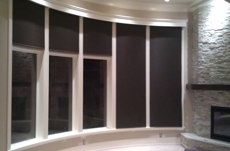Insolroll motorized Roller Shades on a curved wall.